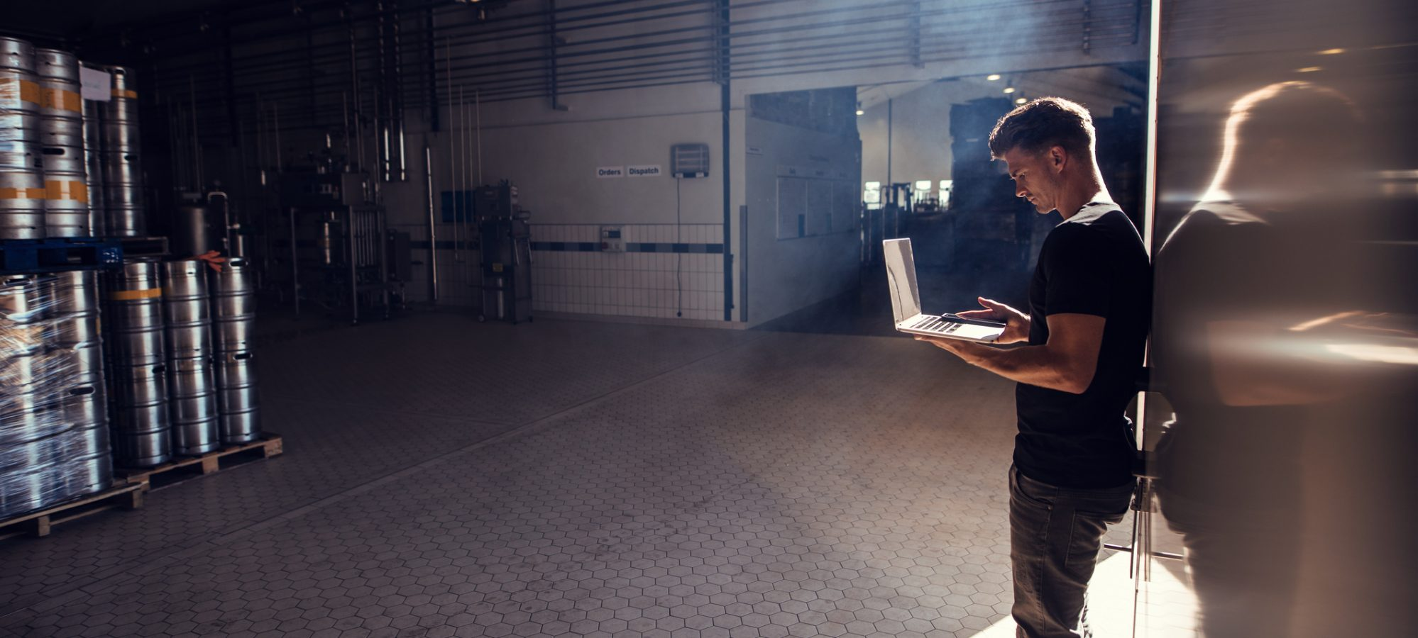 Image of brewery owner using laptop to research bonus depreciation