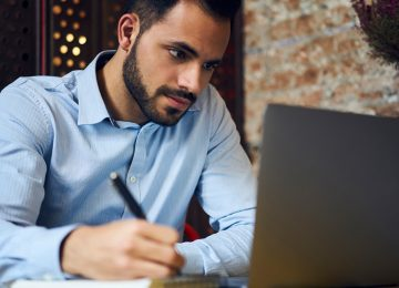 Image of young man working on laptop