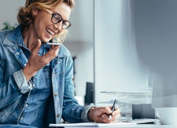 Image of woman talking on phone and asking questions about incorporating her business