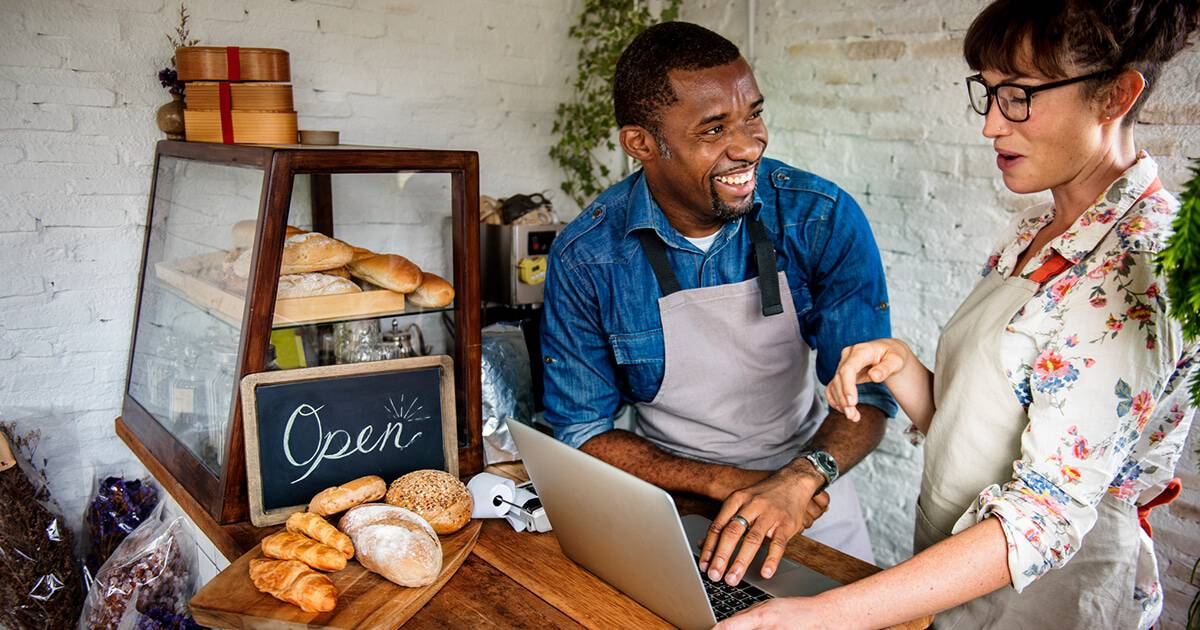 Image of two business owners in bakery who are starting a business