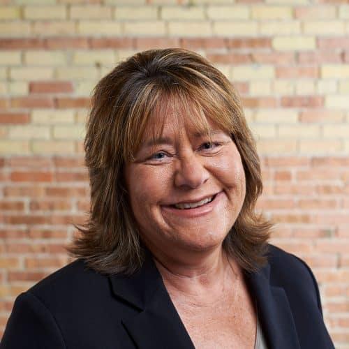 Image of Ann Plummer in Beene Garter office
