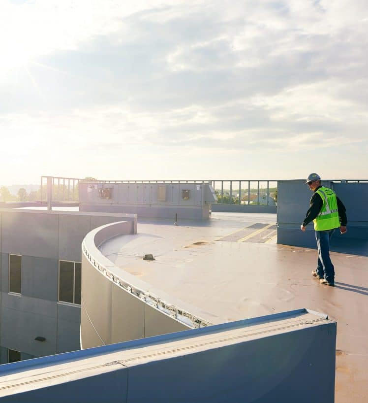 Image of construction worker walking on roof of building on Beene Garter's home page