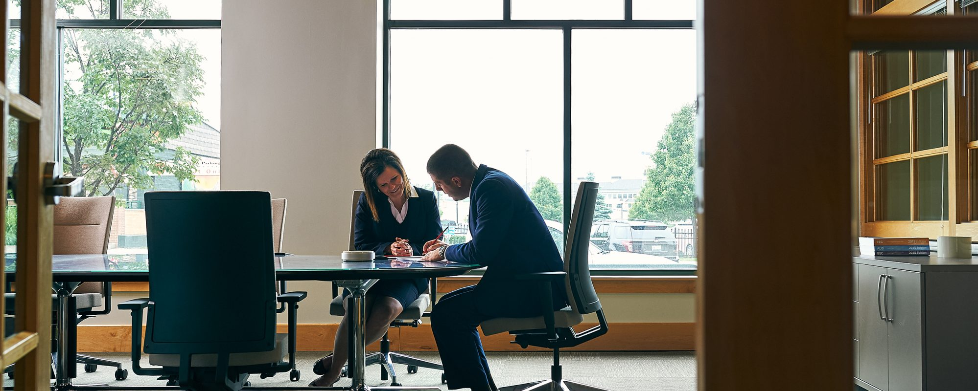 Image of Beene Garter employees working together in office on business tax page