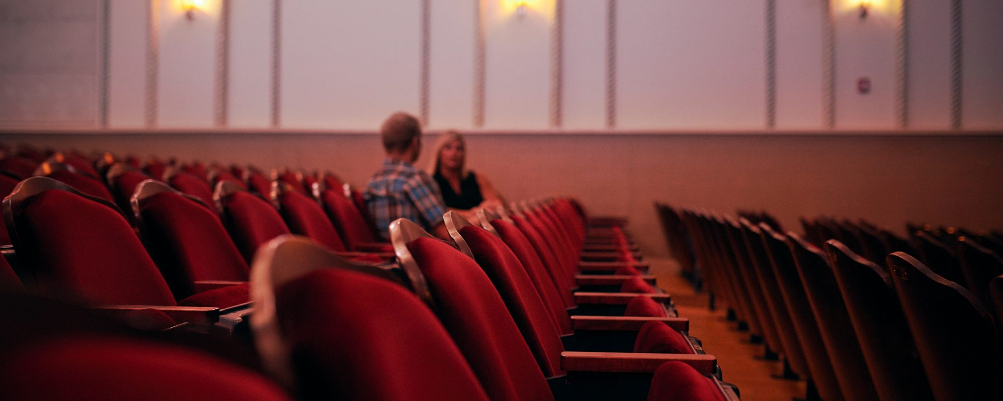 Image of two moviegoers talking in theater on Beene Garter's nonprofit tax page