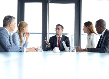 Image of co-owners discussing buy-sell agreement and terms