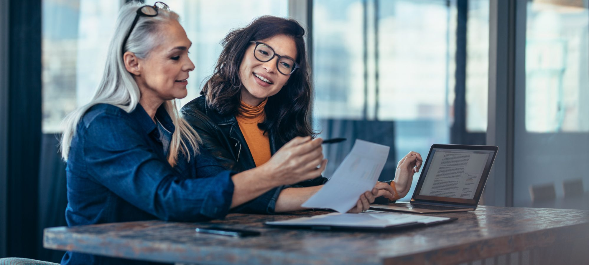 Image of two women analyzing documents about valuation discount regulations and estate plan