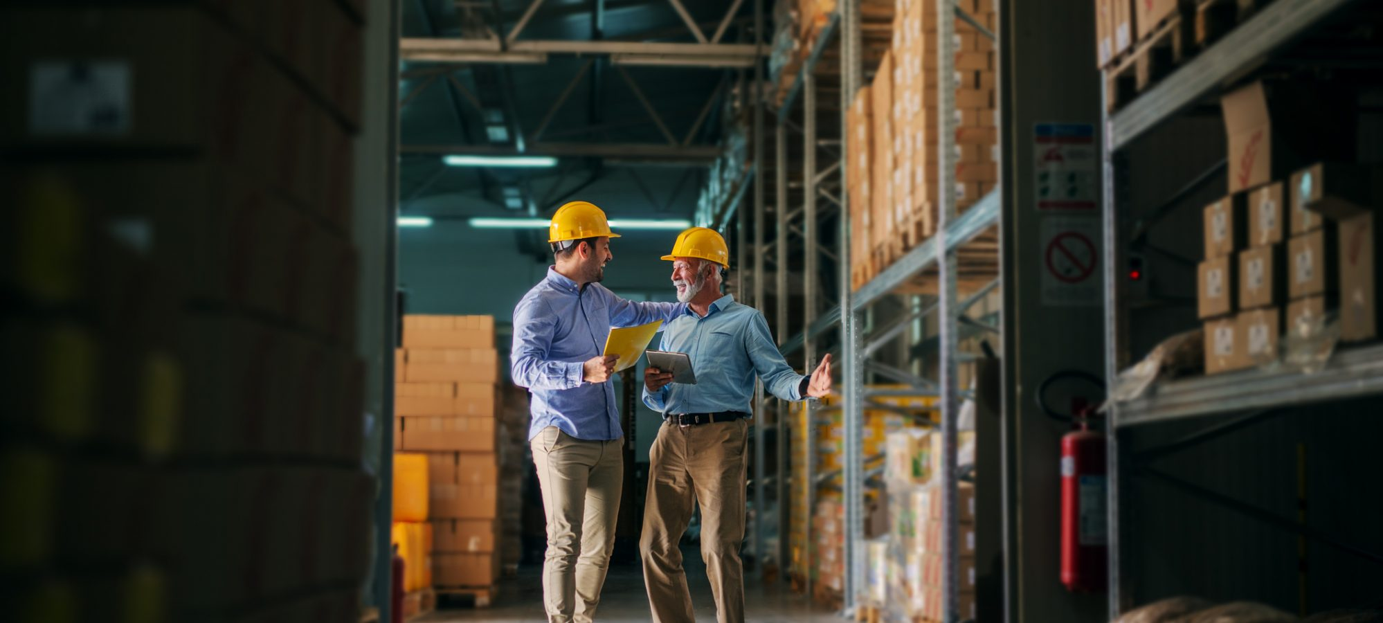 Image of two men standing in warehouse and valuing inventory