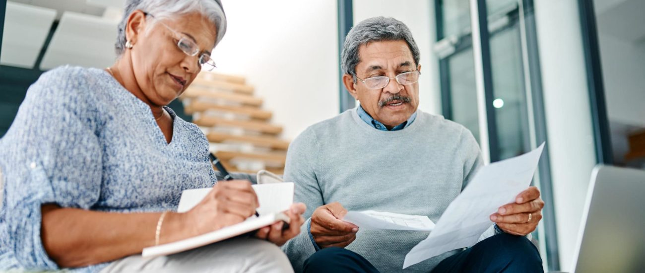 Couple reviewing and gathering tax documents for tax season