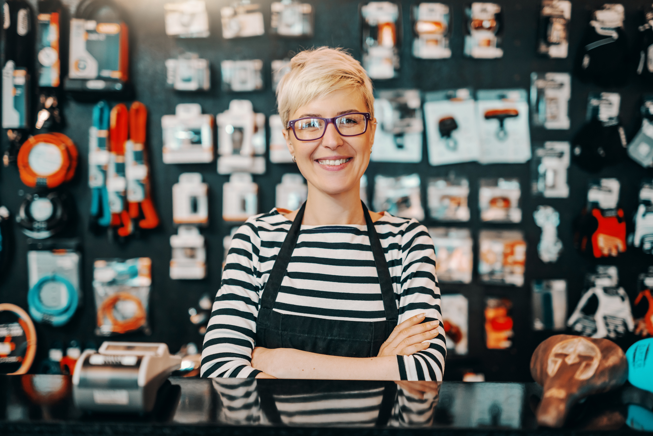 woman poses smiling in her store