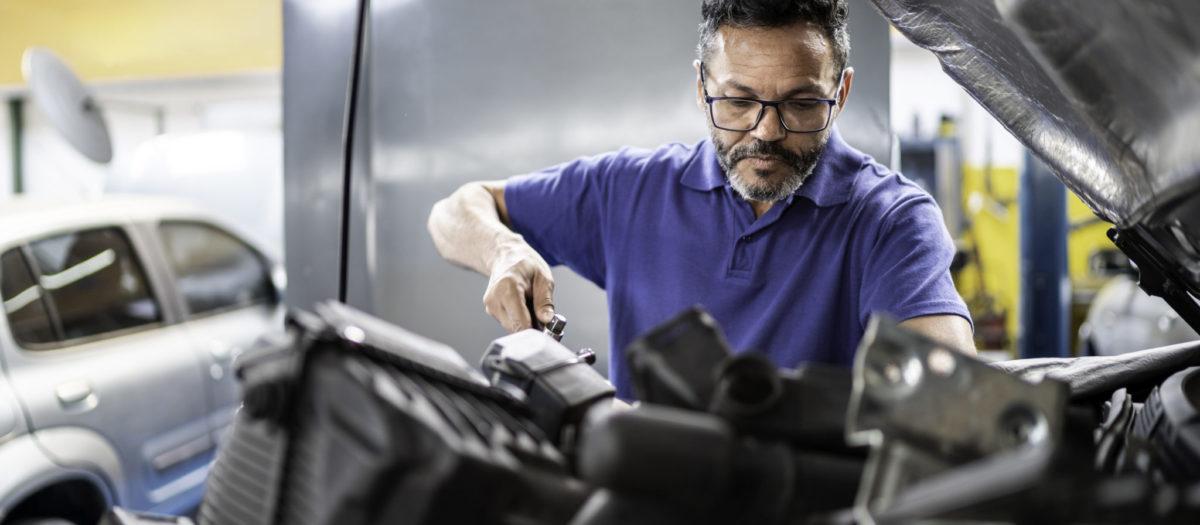 Man repairing a car in auto repair shop