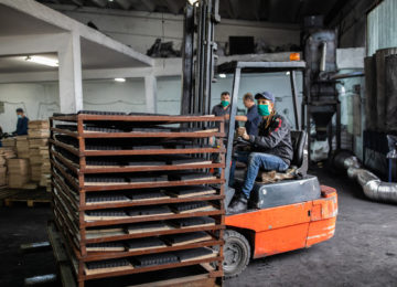 Forklift driver wearing PPE in a warehouse - qualifies for industrial processing exemption