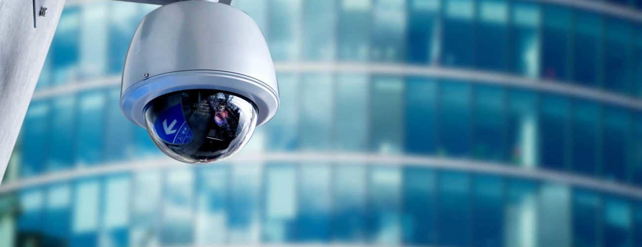 Security camera mounted on office building to detect fraud