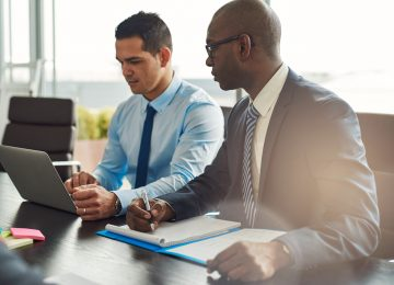 Two business executives in meeting and discussing the value of their business