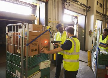 Image of warehouse manager overseeing a delivery and setting tone to protect inventory