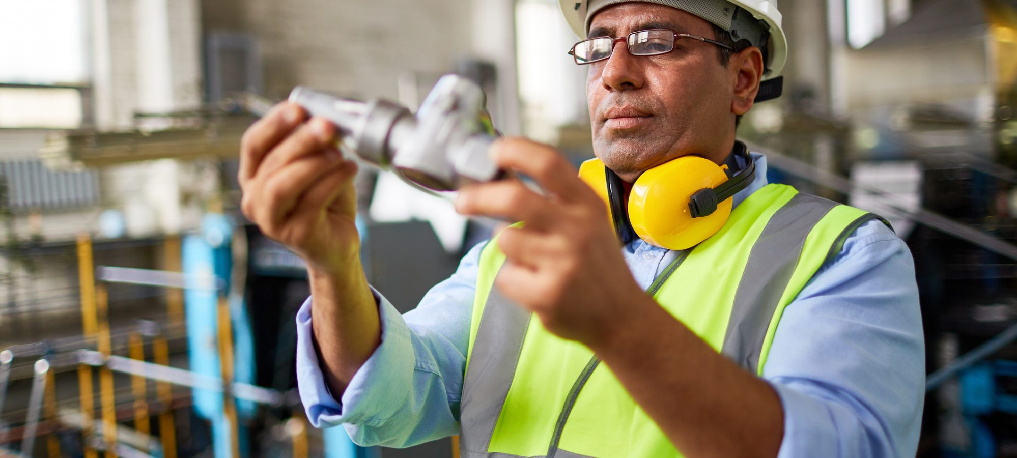 Technician checking product for quality control - activity could qualify for PPT exemption