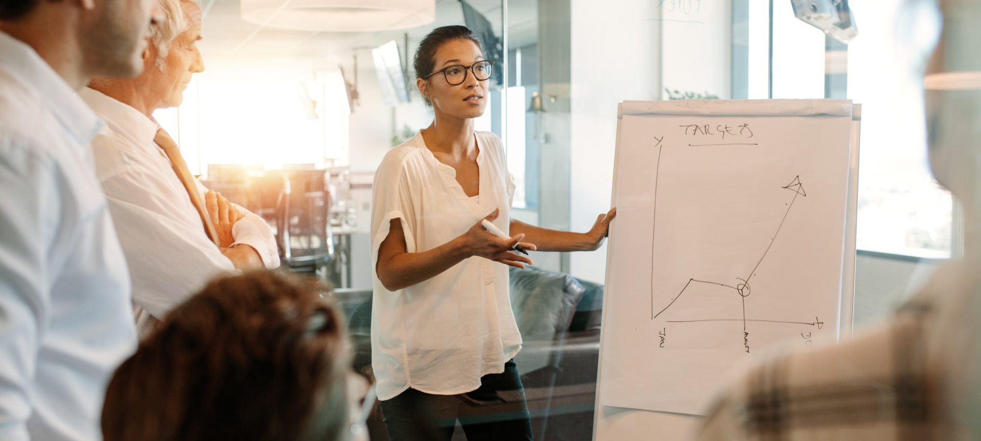 Nonprofit staff member presenting graph of nonprofit's financial metrics