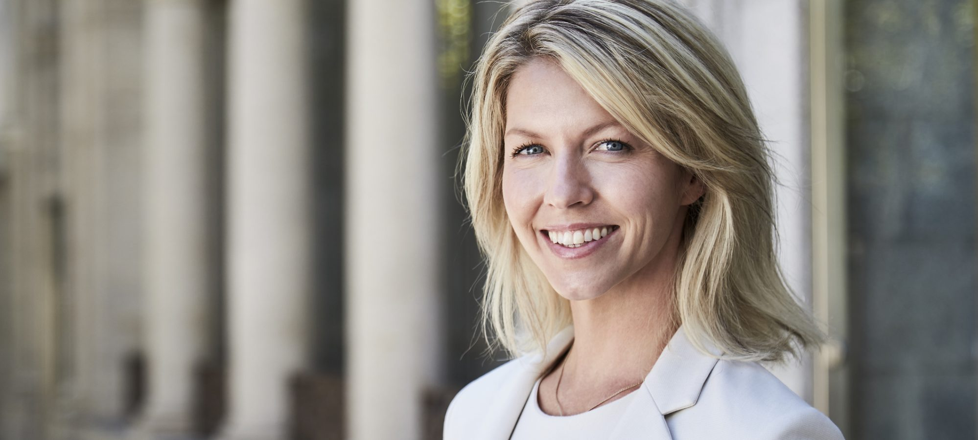 Image of woman accountant smiling at camera - Beene Garter has high percentage of female owners