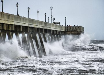 Image of storm surge from hurricane on pier - natural disaster