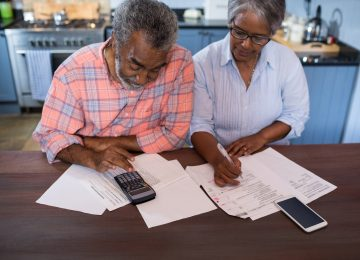 Image of couple reviewing their financial situation in kitchen at home