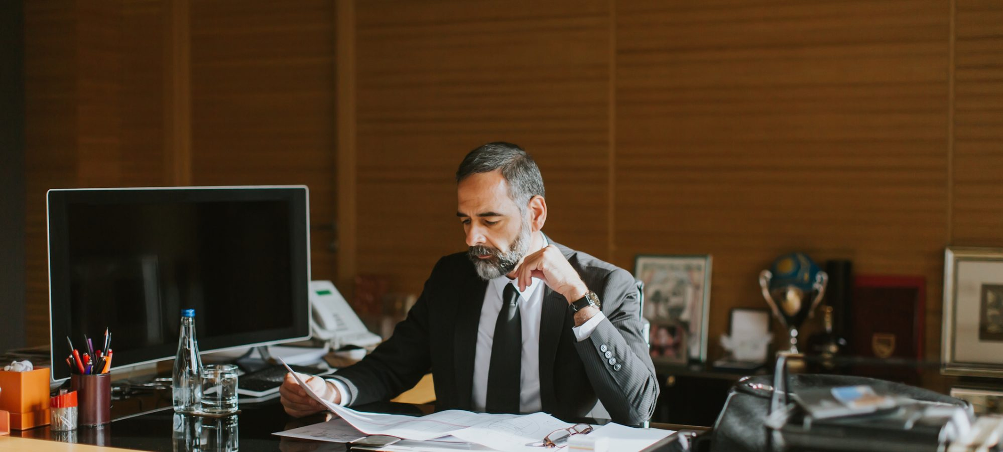 Image of business man working at desk in office
