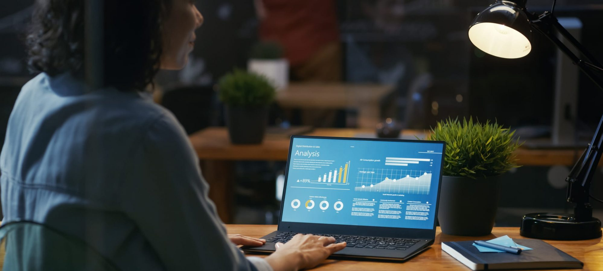 Woman using laptop working in core financials