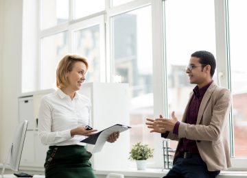 Image of buyer discussing how to raise capital with banker